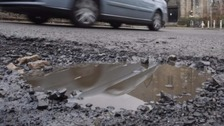 Students try to solve the pothole problem