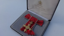 Hunt for owner of OBE medal found dumped in rubbish