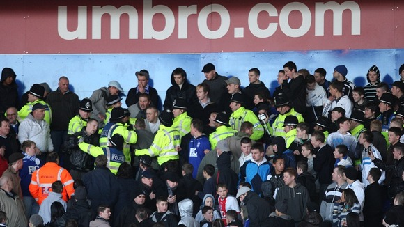 Police move in to control Birmingham City fans during Birmingham City v Burnley in St Andrews&#x27; Stadium. Picture date: 07/02/2009.