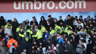 Police move in to control Birmingham City fans during Birmingham City v Burnley in St Andrews' Stadium. Picture date: 07/02/2009.