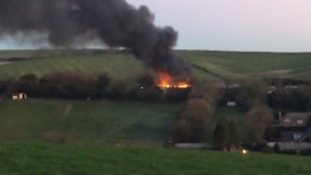 Video: fire destroys workshops and cuts power to Dorset village