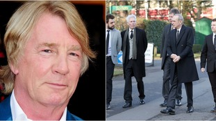 Status Quo band mates arrive by tour bus for guitarist Rick Parfitt's funeral