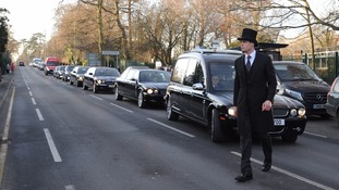 The hearse pulls into the crematorium.