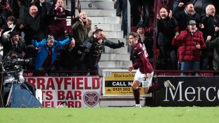 Robbie Muirhead celebrates after scoring for Hearts.
