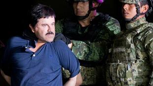 A handcuffed El Chapo.