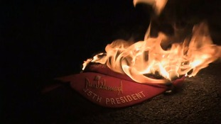 Activists burn a Donald Trump hat in New York.