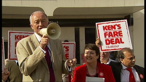 Ken Livingstone addresses a crowd on a megaphone.