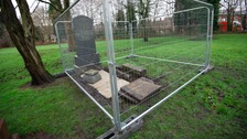 Human remains 'tampered with' after grave smashed open