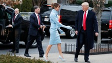 Donald Trump donned his trademark red tie while Melania Trump sported a powder blue dress.
