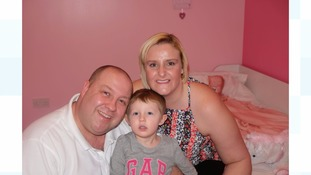 Grace Frazer with her father Darren and mother Fiona