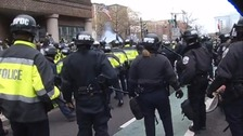 Riot police clash with violent demonstrators in Washington