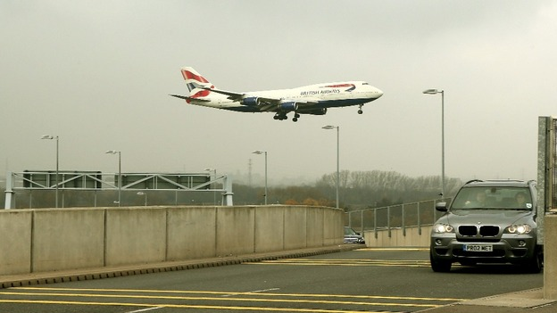 A plane lands at Heathrow Airport as overnight fog caused travel disruption across the UK.