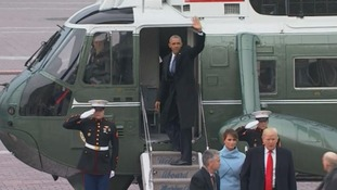 Obama waves goodbye as he boards helicopter
