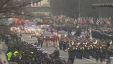 Trump is led by heavy security as inaugural parade drives through Washington