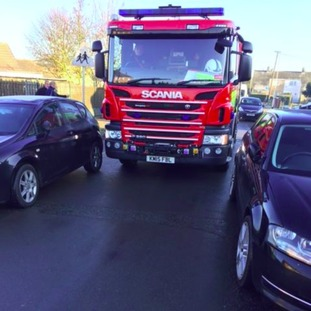 A fire engine struggles to get access to a road in Huntingdon.