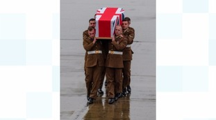 Scott Hetherington's coffin carried by his regimental colleagues