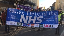 Protestors march through Brighton calling for better funding for the NHS