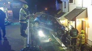 a car has hit a house in south devon
