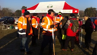 Search teams waiting to begin on Sunday morning.