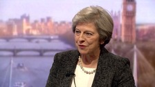 May 'not afraid' to challenge Trump