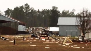 Severe storms have left 11 people dead and a trail of destruction in Georgia, USA.