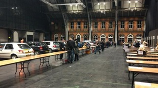 Cars drop ballot boxes off at the Manchester Central Convention Complex