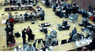 Ballots being verified