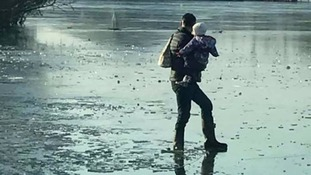 Warning issued after photo shows man carrying child on frozen lake
