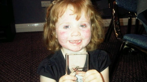 Five year old Sophia Evans with her award.
