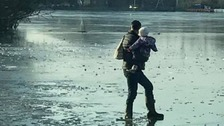 On thin ice: 'crazy' man on frozen lake with small tot