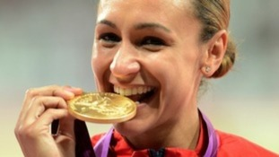 Jessica Ennis getting to grips with her gold medal at the London 2012