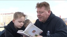 Singe Green reading with his children
