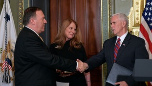 Mike Pompeo (left) was sworn in as CIA chief by vice-president Mike Pence