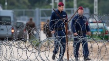 A charity alleges Hungarian police are illegally forcing migrants back across the border