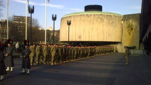 Soldiers gather for the start of their inspection by the Lord Mayor