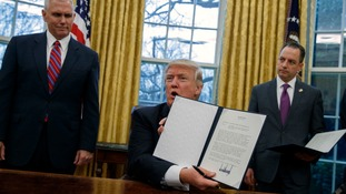 Donald Trump with his executive order withdrawing the US from the Trans-Pacific Partnership.