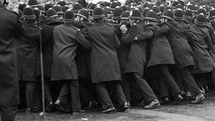 Police pushing against a section of the miners' picket outside the Orgreave Coking Plant near Rotheram in 1984.