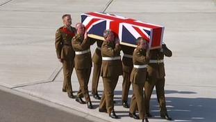 Comrades from the Second Battalion the Mercian Regiment carry Captain Rupert Bowers' coffin
