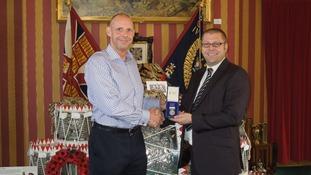 Stan Bates (left) reunites Mick France with his missing medal