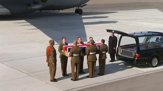 Comrades from the Second Battalion the Mercian Regiment put Captain Rupert Bowers' coffin in hearse