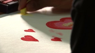 One detainee draws a picture of hearts.