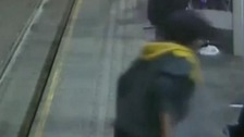 Police are hunting for a man who appeared to launch an unprovoked attack on a woman waiting for a tram in Birmingham.