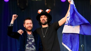 Tom Meighan (left) and Sergio Pizzorno of Kasabian on stage in Victoria Park