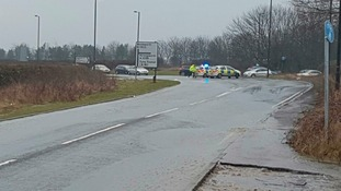 Police at the scene of a burst water pipe near the A19 on Thursday