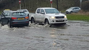 Traffic struggling through floodwater on Thursday