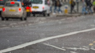Snow falls as London shivers in freezing temperatures