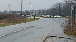 Police at the scene of the burst water pipe on Thursday