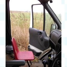 The van stopped by police who found a chair was being illegally used as a passenger seat