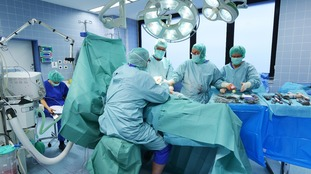 A patient undergoes a hip replacement operation