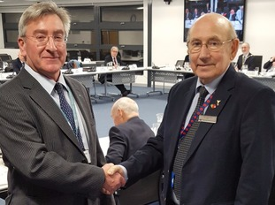 Council leaders Ray Herring and Colin Law shake hands after the deal is agreed.